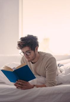 Concept - in bed curled up with a book