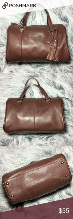 Authentic Coach Leather Hand Bag With a Tassel Authentic Chocolate Brown Coach Leather Handbag With a Tassel un good preowned condition, no stains or holes outside, handles are in good condition, inside needs some cleaning and is missing the long strap, but definitely lots of life left 😍 Coach Bags