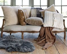 love the neutral tones of these pillows and throws http://rstyle.me/n/q8farr9te