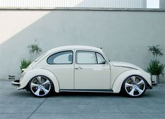 vintage white vw beetle - looks like the '73  my Mom had (hers was powder blue) but with rims from a newer Golf  VW