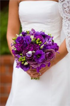 Bouquet of differing shades of purple and green flowers.