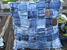 Denim pillow sham made from weaving waistbands from recycled jeans.