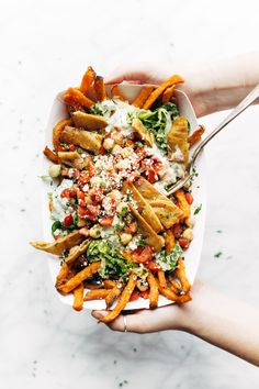 Loaded Mediterranean Street Cart Fries: sweet potato fries topped with fresh romaine, tzatziki, marinated tomatoes and chickpeas, feta cheese, and more. Meatless and mind-blowing, all in one. #dinner #glutenfree #vegetarian #recipe #appetizer   pinchofyum.com Vegetarian Dinners, Vegetarian Recipes, Cooking Recipes, Healthy Recipes, Keto Recipes, Delicious Recipes, Healthy Junk Food, Potato Recipes, Chicken Recipes