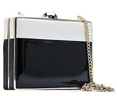 Mango black/white patent box clutch. Debuted 2011. Click for more details
