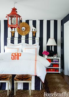 Covering the walls, headboard, and bed skirt, in the same fabric — a striped Ralph Lauren Home silk — is a tried-and-true decorating solution for unifying a small room. Bedding from Leontine Linens. - HouseBeautiful.com