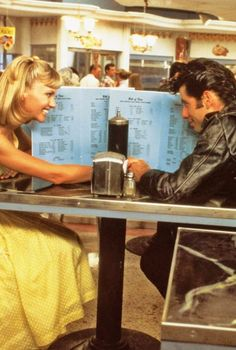 **Grease (1978) John Travolta, Olivia Newton-John, Stockard Channing, Jeff Conaway - Director: Randal Kleiser - MUSICAL - Greaser Danny Zuko falls for sweet girl Sandy over the summer break.    Back in school, they find it hard to carry on a romance.
