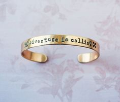 Adventure is Calling,Inspirational brass quote cuff bracelet with crossed arrow design by ZennedOut