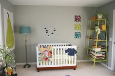 I like the splashes of color in this nursery. Nice wall paint color too.