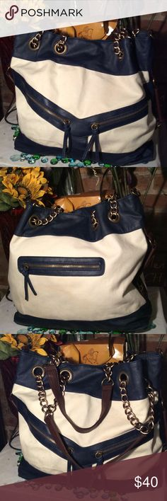 Deena & Ozzy Bag Gorgeous two tone bag- Navy/White- Brown trim- Vegan leather- Clean bag- (3) Exterior zippers- Missing shoulder strap- Good condition- Sz 13x17- (2) 9' handles- Very nice bag. Deena & Oozzy Bags Shoulder Bags