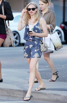 Keep it casual and romantic in a floral printed romper. (Amanda Seyfried)