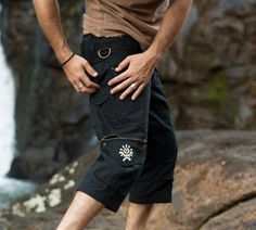 Our pants are handmade super comfortable, durable and stylish. . .    This is a three quarter (under knee) version of our Kru design. . .    Featuring four large pockets sealed with zips, multiple small pockets  (including a secret pocket) and ring to clip on your water bottle. . .   these pants are perfect for festivals, various practical work jobs and everyday use. . .    Join the Kru and be ready for any mission accompanied by this functional ally!    We use the highest quality metal YKK…