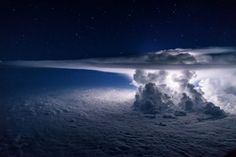 Thunderstorm photographed over the Pacific Ocean at night. The photographer and pilot, Santiago Borja, says he was circling around it at 37,000 feet altitude en route to South America when he captured...