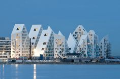 isbjerget housing project in aarhus, Denmark by seARCH, CEBRA, JDS   louis pail lard: I'm starting to think this Danish people live in fairytale land, just wanna see the white iceberg disappear under the white snowy landscape in winter...so nice white on white!