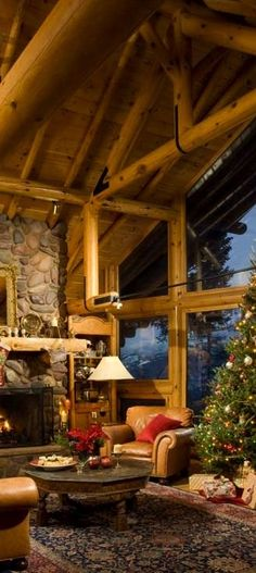 Canadian Log Homes~ Rustic Christmas Decorating Ideas. My favorite part of this picture is the metal on the beams.