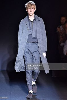 A model walks the runway during the Wooyoungmi Ready to Wear Menswear Spring/Summer 2016 show as part of Paris Fashion Week on June 27, 2015 in Paris, France.
