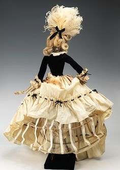 """""""1774 Doll"""" Designer: Jean Dessès (French (born Egypt), Alexandria 1904–1970 Athens) Gervais Date: 1949 Culture: French Medium: metal, plaster, hair, silk, feather, leather, glass, cotton. Back"""