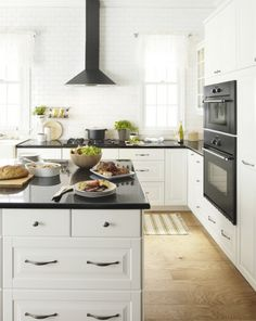 Different Layout But Similar To IKEA With Black Appliances And White  Cabinets. Black Counters And