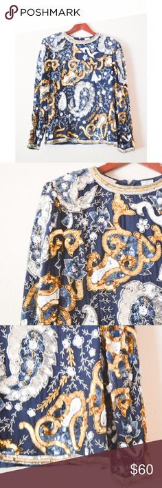 VINTAGE 1980's Sequined Blouse DETAILS  ♡ brand: lawrence kazar ♡ era: 1980's ♡ condition: excellent ♡ color, navy, white, gold, blue ♡ size: large ♡ material: outer is 100% silk, lining is 100% rayon  MEASUREMENTS ♡ length: 24 inches ♡ bust: 19 inches ♡ sleeves: (from armpit) 17 inches   NO SWAPS **has shoulder pads Vintage Tops Blouses