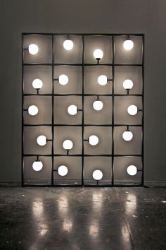 So wird aus Licht Kunst! Wunderschöne Lampe für ein kreatives Zuhause. >> ATELIER ARETI, SQUARES: 20 squares and spherical bulbs lit by LEDs. this is such a cool sculptural object/lighting piece.