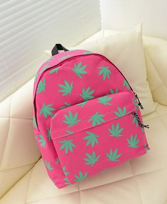 [via Etsy] A girly, hot pink, marijuana leaf backpack!