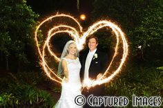 Bride & Groom make a heart with sparklers