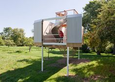 Playhouse on stilts by Sharon Davis features a slide, a climbing frame and a lookout point.