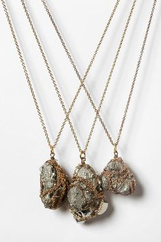 this necklace is basically a chunk of pyrite. which is awesome, because pyrite was my favorite mineral as a kid. nostalgia. plus, rocks/minerals are huge right now. and like...it's shiny and gold and raw. what's not to love? (yes, it's from urban. whatevs.)