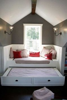 Treat a window seat like its own little room with panelling and light fixtures. This window seat obviously moonlights as a guest bedroom with a trundle bed and pillows that are part and parcel of the bedding. Attic Bedroom Designs, Attic Rooms, Attic Spaces, Small Spaces, Attic Bathroom, Attic Design, Attic Playroom, Attic Apartment, Small Rooms