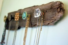 Driftwood Jewelry Rack: Adopt a lonely piece of driftwood next time you're at the beach and bring it home for this resourceful DIY. We love the rustic feel the unfinished wood and medley of knobs give this jewelry rack. (via Visibly Moved)