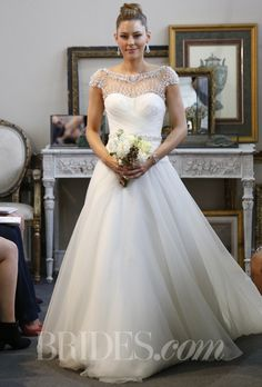 "Want the 20s glam but are an inner princess too? Try on this number. Brides.com: Wtoo - Fall 2013. ""Pandora"" wedding dress"