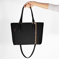 I need this!! It's kind of expensive, but I think I'm going to start saving..That's saying a lot!! The Mini Tote - Dagne Dover