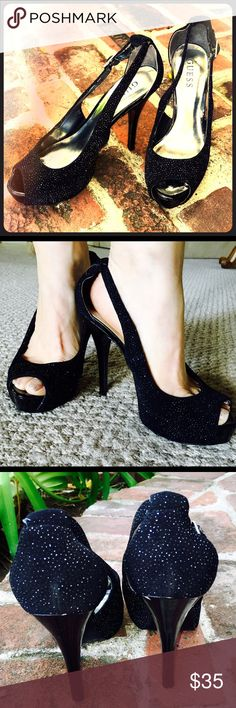 Guess Platform Pumps  Black Glitter  Sexy Black Glitter Pumps  Worn a few times only! Has a small chip/scrape on back left  heel (see picture) Barely noticeable.  A little wearing on inside liner but very, very cute.  1/2 size too big, otherwise they are darling! Guess Shoes Heels
