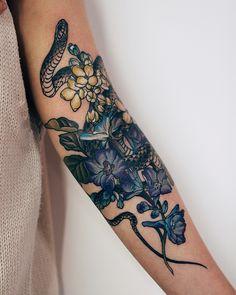 White lilac and Delphinium grandiflorum, a snake. Done at Cover work. White lilac and Delphinium grandiflorum, a snake. Cool Chest Tattoos, Chest Tattoos For Women, Badass Tattoos, Unique Tattoos, Cute Tattoos, Beautiful Tattoos, Small Tattoos, Side Arm Tattoos, Bow Tattoos