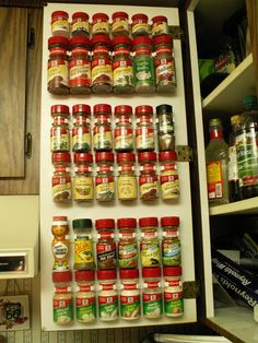 SPICE RACK on the inside of a kitchen cabinet door. I did this in my kitchen, it was so easy, and saves so much space. Easy to see all the spices. Get the bottle holding strips on Amazon - 8 dollars for 20 clips (click to go to link) - Best thing I ever did!!!