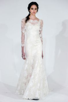 Wedding dress with lace sleeves by Claire Pettibone.