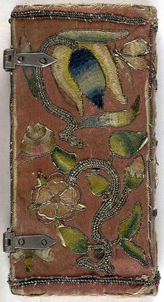 Back cover of 17th century embroidered satin book with two sets of metal clasps. by Aria Nadii, via Flickr