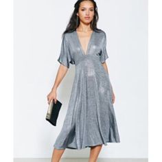 Oh My Love London Midi Dress from Anthropologie NWOT-Brand new, never worn, lovely grey/silver shimmery dress. Material is so soft and flowing. So elegant and perfect. 95% polyester & 5% elastane. Anthropologie Dresses Midi