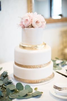 Gold and white cake with pink peonies: http://www.stylemepretty.com/canada-weddings/2014/10/21/romantic-canada-wedding-at-ancaster-mill/ | Photography: Karyn Louise - http://karynlouisephotography.com/