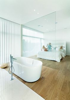Nice sleek and clean design of an open plan bathroom/bedroom.