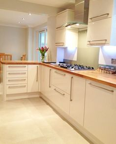 Cream Units & Oak Worktops: