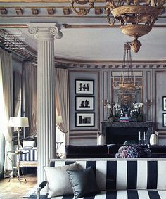 This interior belongs to the Neo-Classicism era. This style was inspired by the Ancient Greek and Ancient Roman era's. The style decorated spaces by use of grand columns and pillars. Popular materials in this era included velvet and silk.