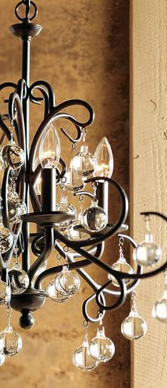 Love the dramatic style created in the contrast of the crystal balls and rustic blackened finish.