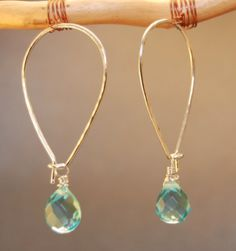 "Long ear wires that hook at the bottom with (non-removable) stone of your choice (peridot, aqua crystal, amazonite, and white agate shown), about 1-3/4"". Available in either 14K gold-filled, rose gold"