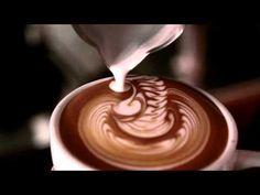 Youtube. A barista performs latte art skills.