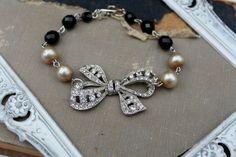 Vintage Rhinestone Glass Pearl and Onyx Assemblage Bracelet...Memories. $60.00,simplymeart via Etsy.