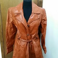 Vintage Rust Leather Trench Awesome 70s vibe! There is a bit of wear on the belt but otherwise this is in great shape! No size tag but fits like a small. (I normally wear a medium and this is a bit tight in the shoulders. ) Reasonable offers welcome through the offer button. Bundle 2 or more items and save! Animal Crackers Jackets & Coats Trench Coats