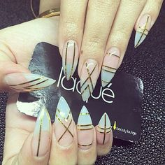 Stiletto nails with light pink and light blue. Like the geometric design.