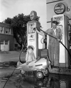 """Previous pinner stated: """"My grandfather Howard McGraw, a photographer for the Detroit News, likely saw the scene in his neighborhood and stopped for the shot. The airplane is an early 1940s Murray Pursuit pedal car with Army decals and machine gun mounts - worth over $1000 today if restored! And the gas pump would likely go for about $3000 restored!""""  Scanned from a 4x5 negative."""