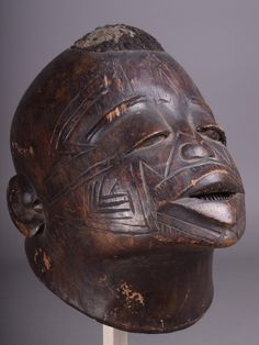 Lot 181 - A Makonde helmet mask Mozambique with a small raised mound of hair with incised scarifications and