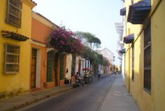 Colourful streets of Cartagena. More on this very romantic city: http://bbqboy.net/travel-tips-and-photo-essay-on-incredible-cartagena-colombia/ #Cartagena #Colombia #SouthAmerica